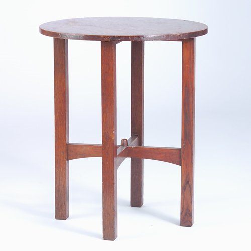 507: GUSTAV STICKLEY Circular lamp table with arched cr