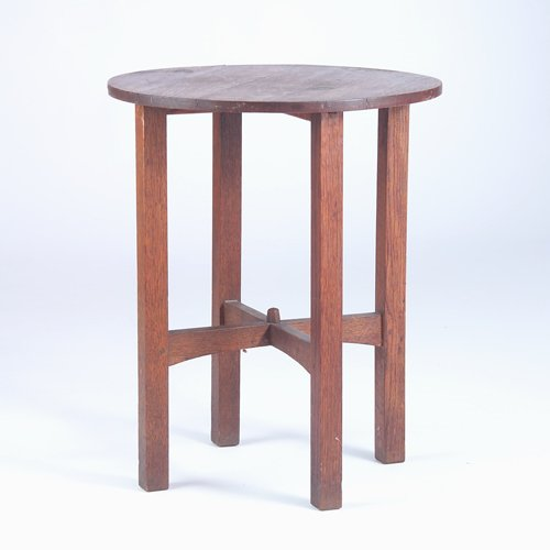 508: GUSTAV STICKLEY Circular lamp table with arched cr