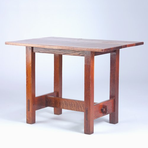 512: GUSTAV STICKLEY Lunch table (no. 647) with an up-e