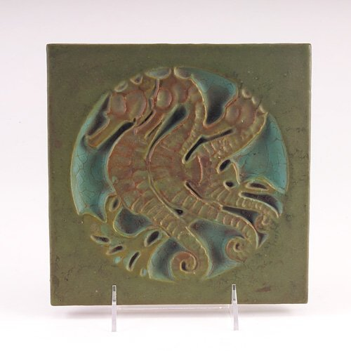 "366: ROOKWOOD FAIENCE Rare 8"" tile embossed with a meda"