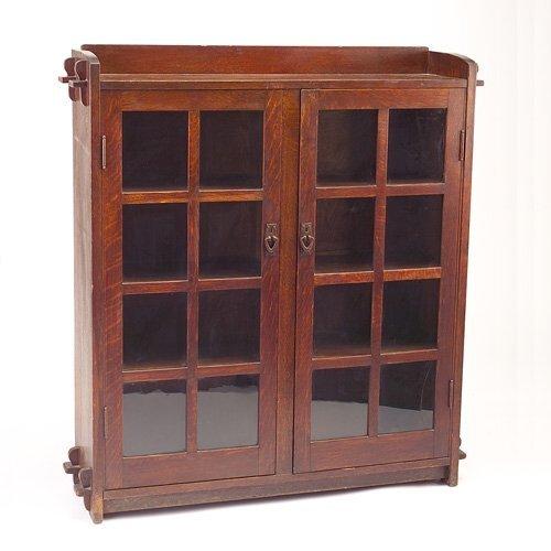 641: GUSTAV STICKLEY Two-door bookcase with keyed throu