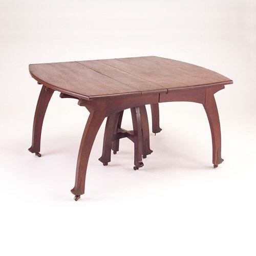 645: GUSTAVE SERRURIER BOVY Rectangular mahogany dining