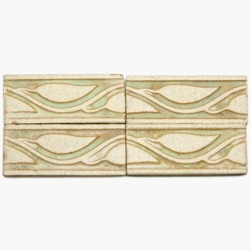 594B: GRUEBY Sixty-eight border tiles embossed with lea