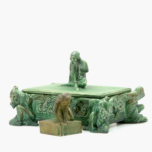 748: ATLANTIC Two figural pieces covered in green vellu