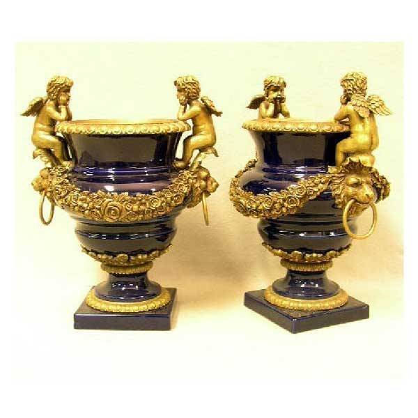 1: Ceramics - A pair of large decorative urns, having b