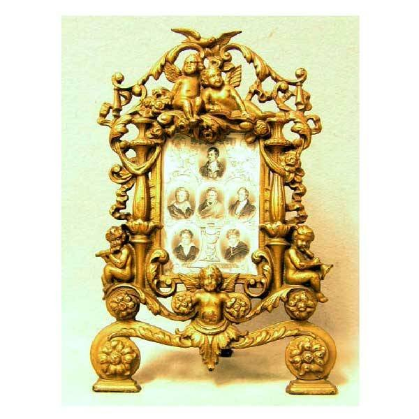4: Brassware - A Victorian copper cast iron frame, with