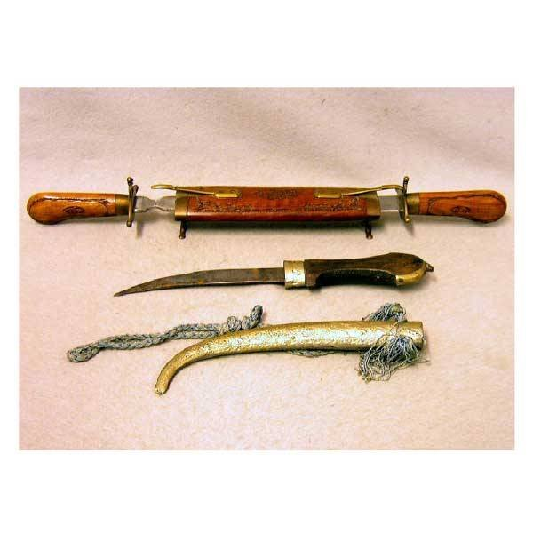 24: Metalware - An eastern dagger with shaped blade and