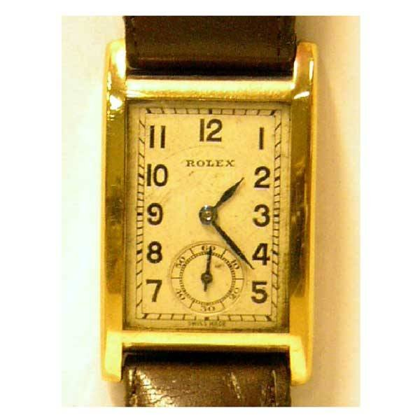2841: Watches - A 1930s 9ct gold Rolex watch, with rect