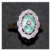 2911 Jewellery  An 18ct gold diamond and emerald ring