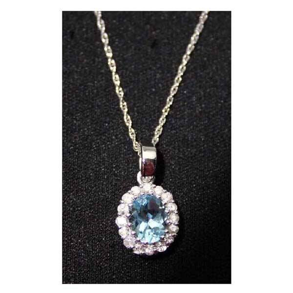 Jewellery - An 18ct aquamarine and diamond cluste