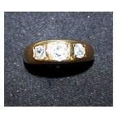 2969: Jewellery - An 18ct three stone diamond ring, wit