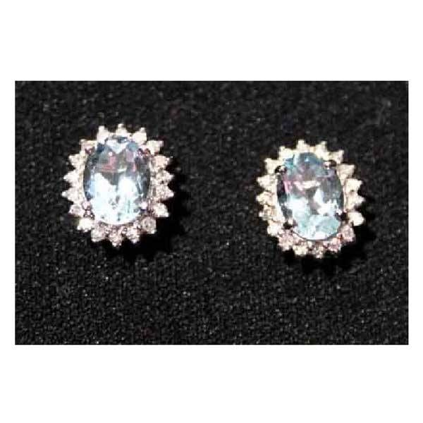 2972: Jewellery - A pair of oval 18ct gold aquamarine a