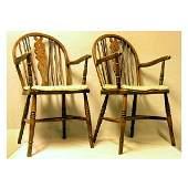 3659: Furniture - A pair of Windsor wheelback elbow cha