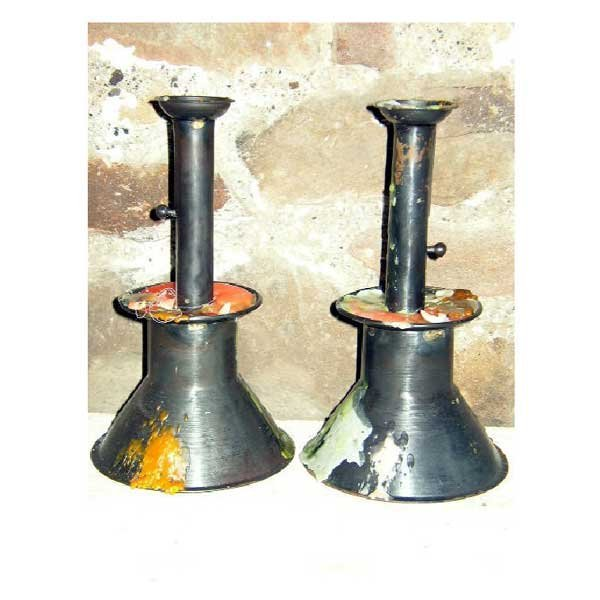 7: Metalware - A pair of iron candlesticks, with taperi