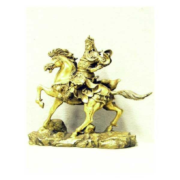 19: Brassware - A gilt brass cast model of an oriental
