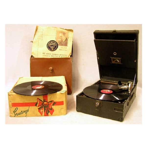 22: Collectable - A portable wind-up gramophone, in wor