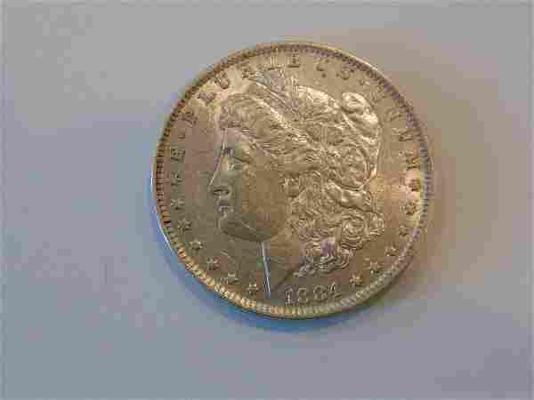 84-O AU Morgan Silver Dollar