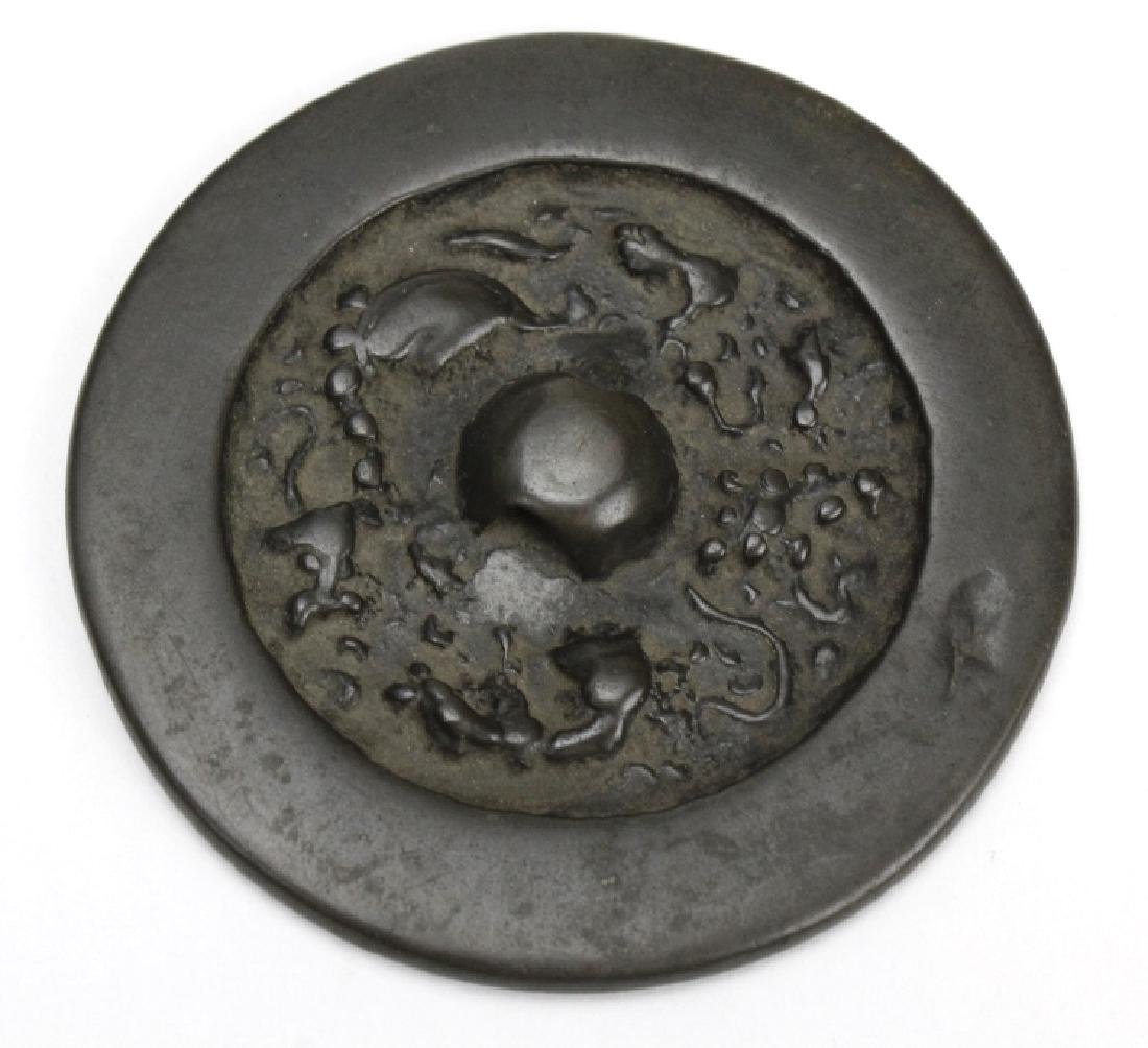 Tang Dynasty Round Lion Grape Bronze Hand Mirror