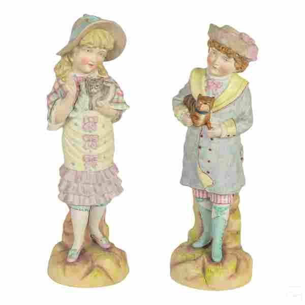 German 19C. Porcelain Bisque Boy & Girl Sculptures