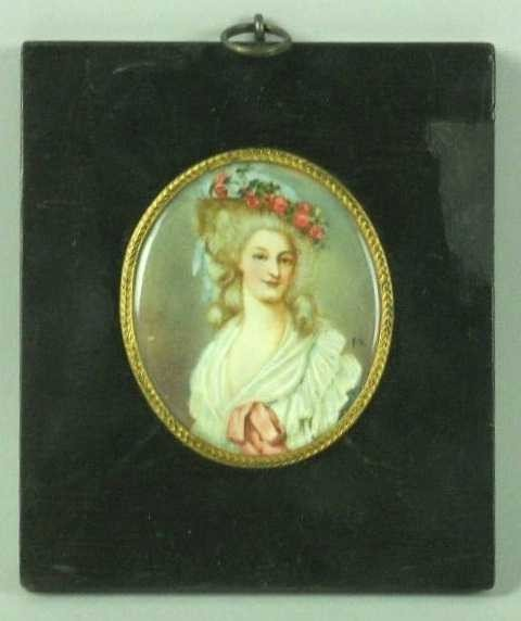 11: PORTRAIT MINIATURE ON IVORY OF A YOUNG WOMAN: