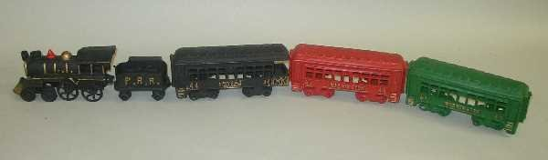 14: VINTAGE CAST IRON TRAIN SET