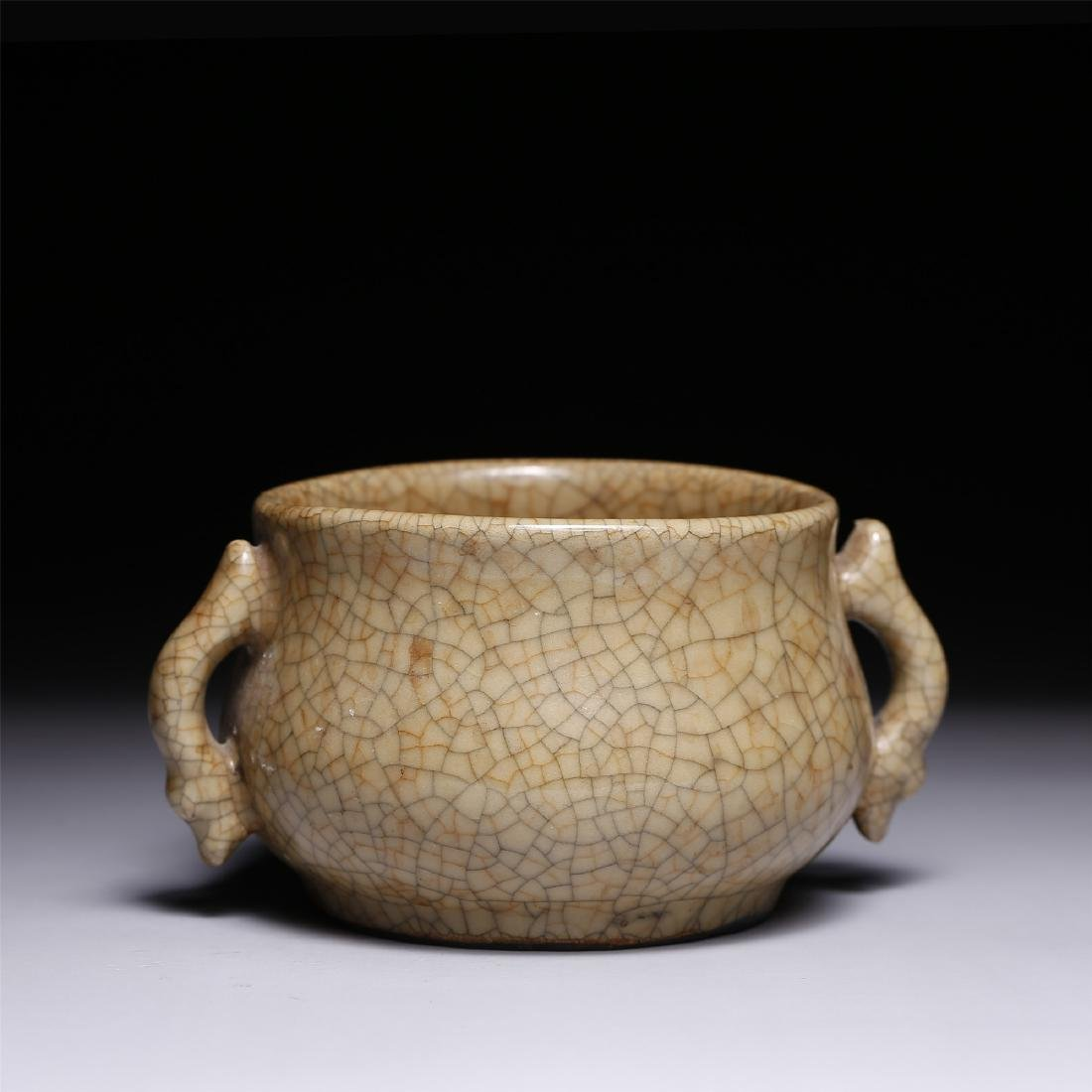 A CHINESE CRACKLE GLAZED TWIN-HANDLE CENSER