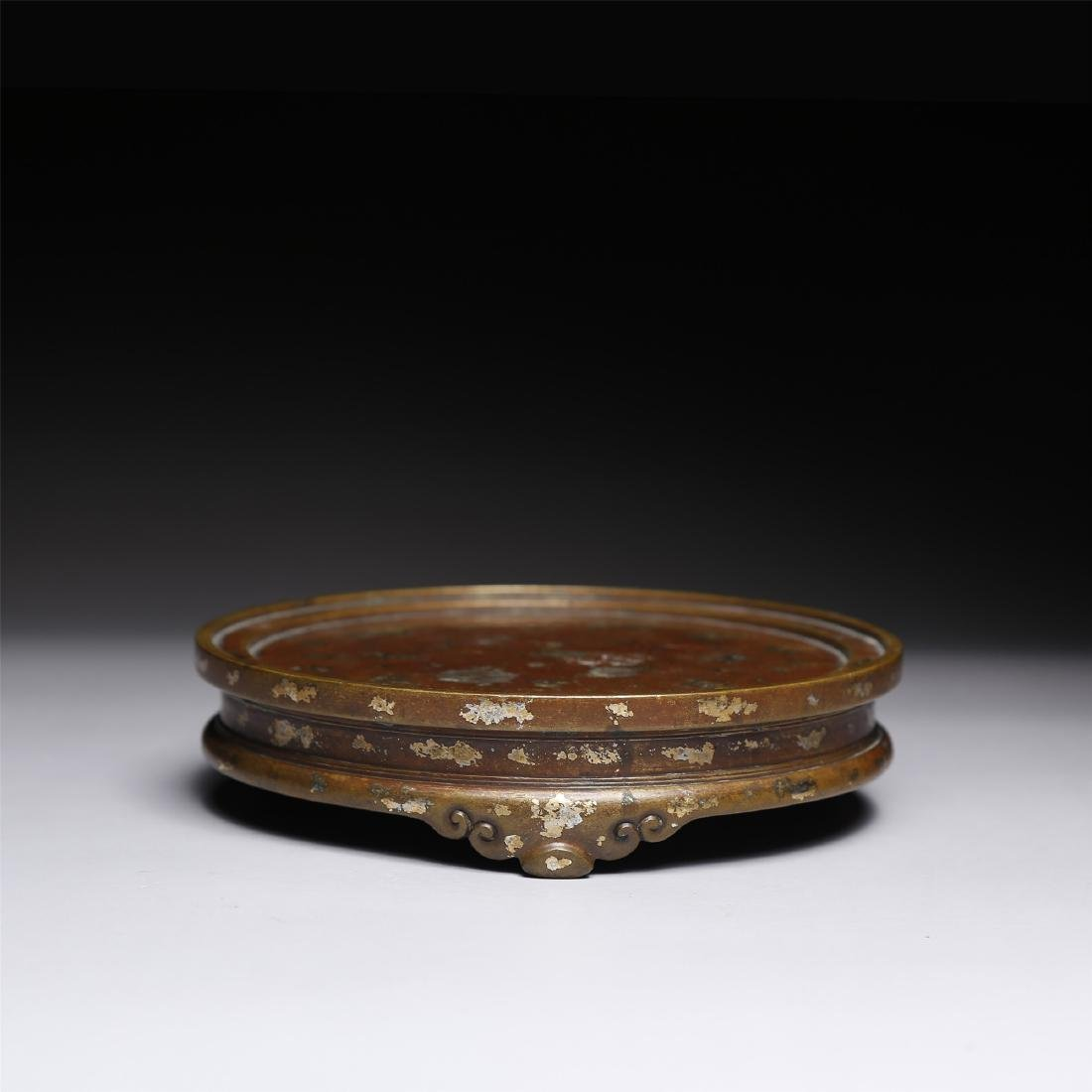 A CHINESE GOLD SPLASH BRONZE STAND
