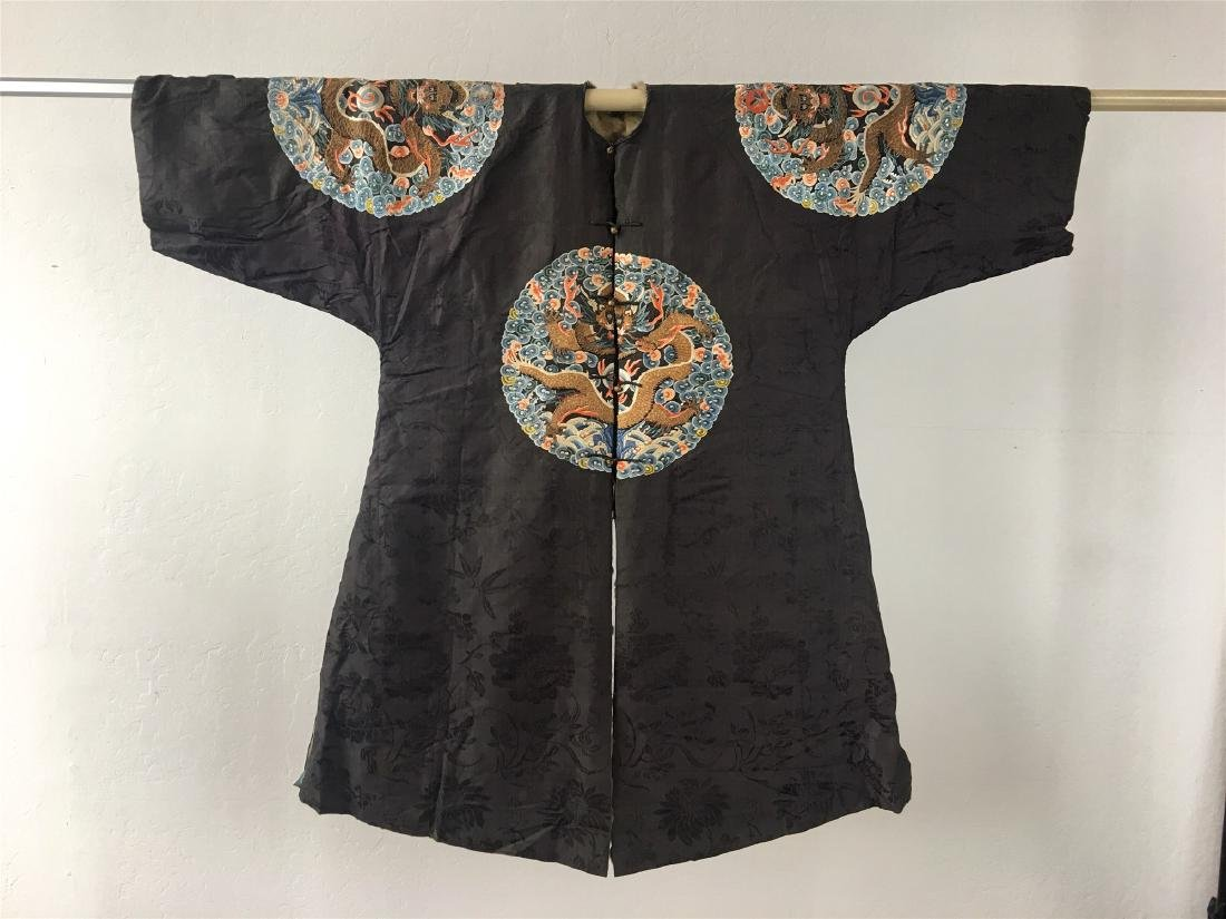 A CHINESE SILK EMBROIDERED FUR-LINED WINTER COAT