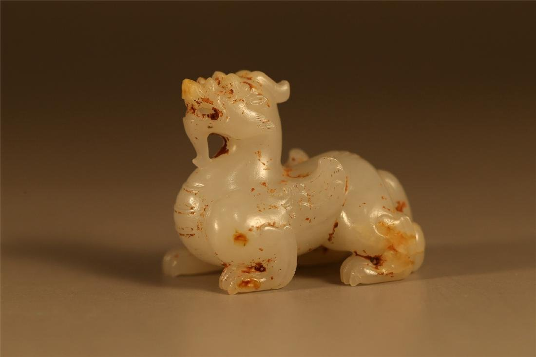 A CELADON JADE CARVING OF A MYTHICAL BEAST, HAN DYNASTY