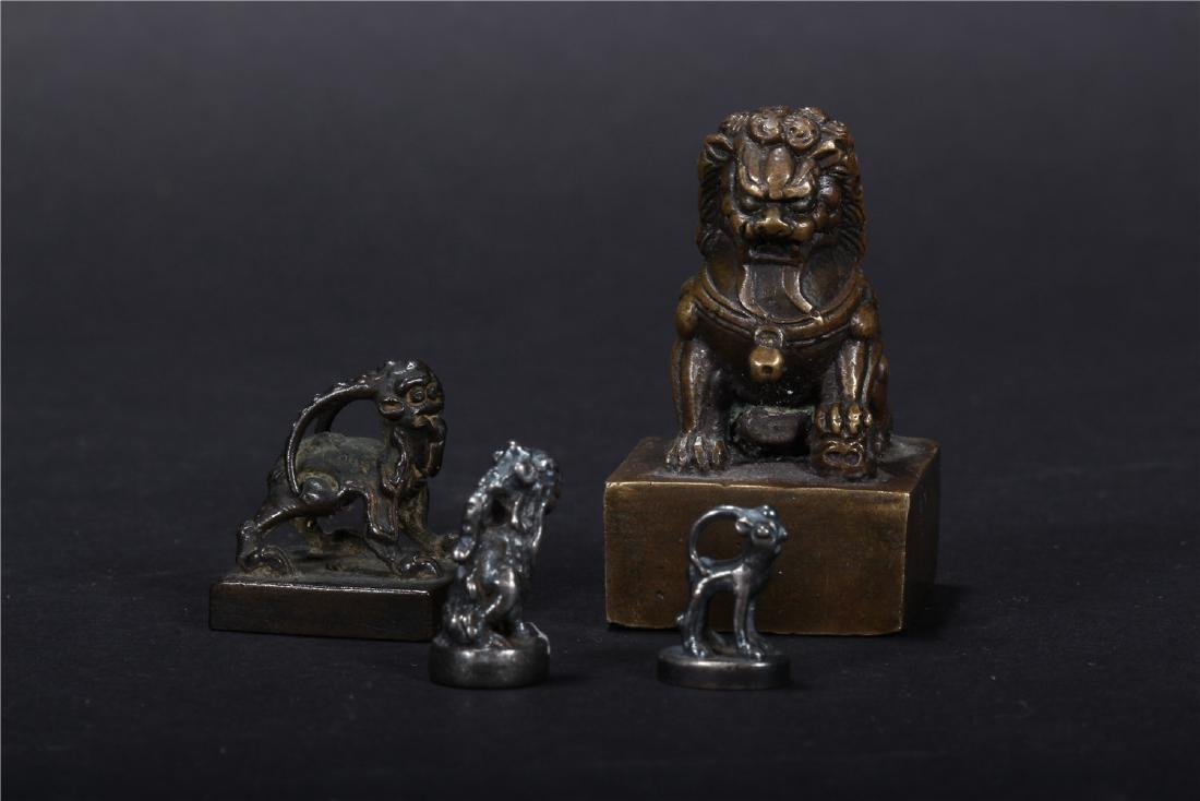 FOUR CHINESE COPPER SEALS