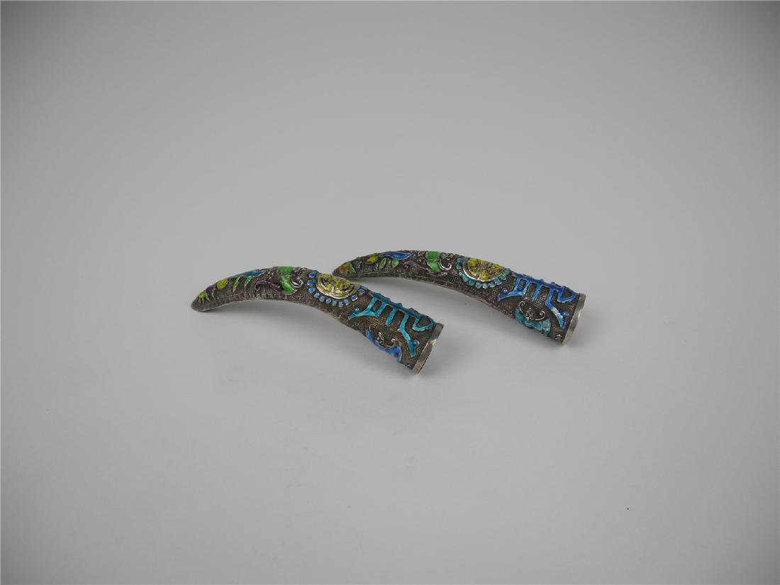 A PAIR OF CHINESE SILVER ENAMELED NAIL ORNAMENTS