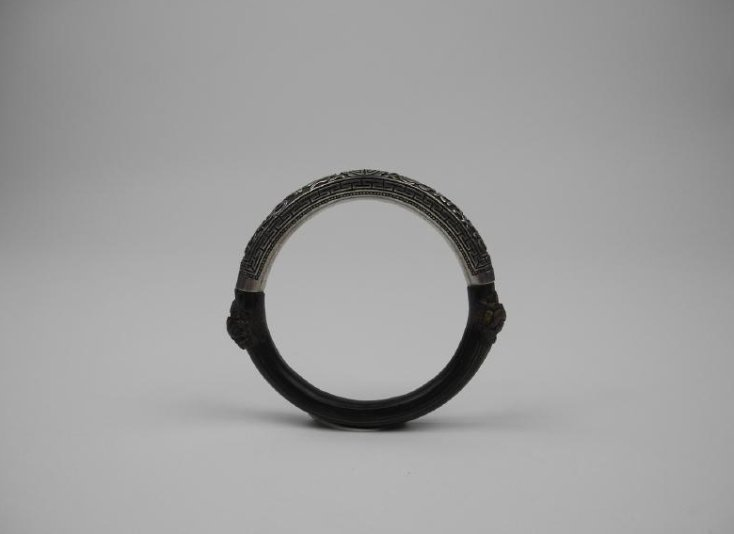 A CHINESE CANE AND SILVER BANGLE