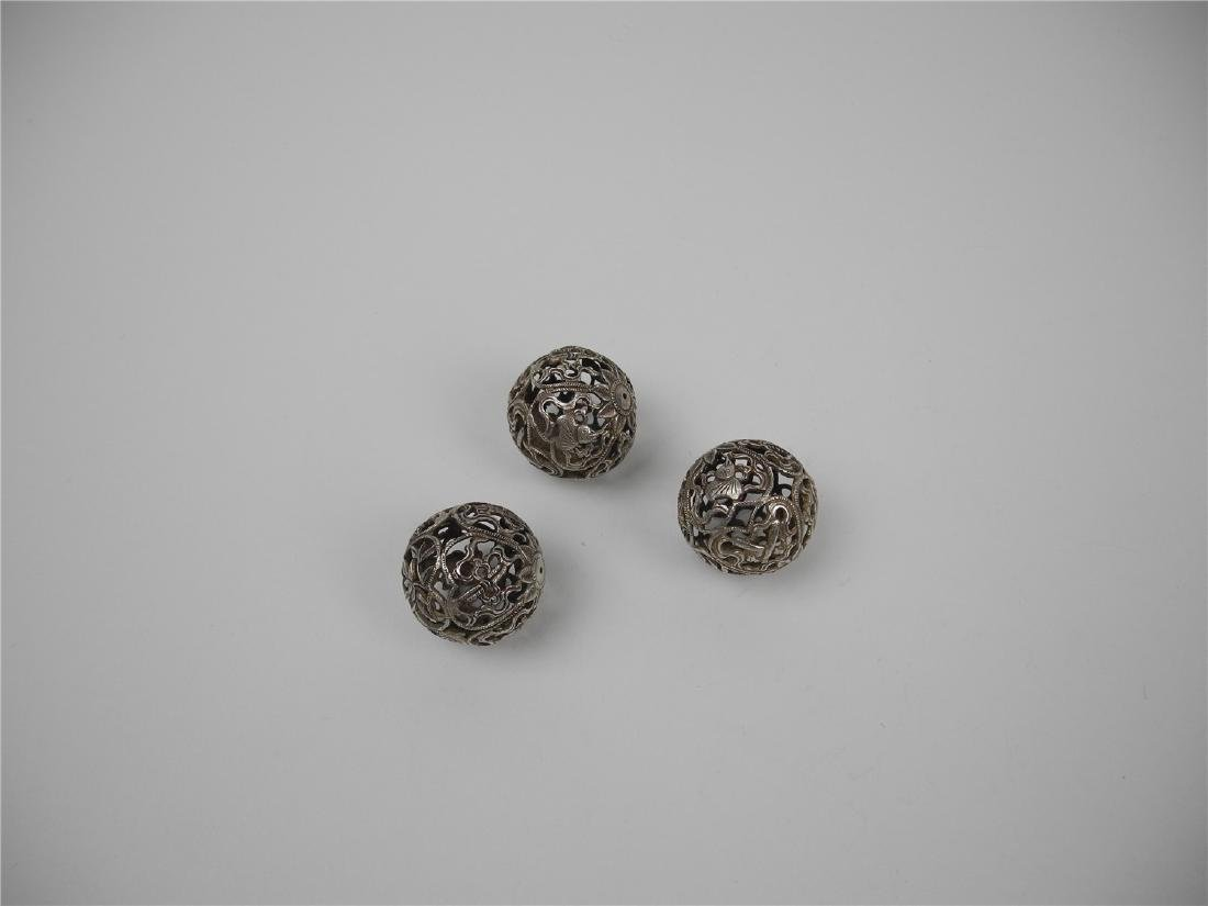 THREE CHINESE SILVER ORNAMENTS