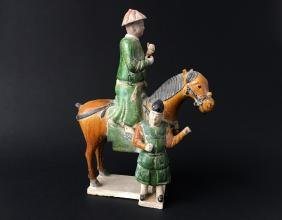 A CHINESE GLAZE POLYCHROME POTTERY MEN AND HORSE FIGURE