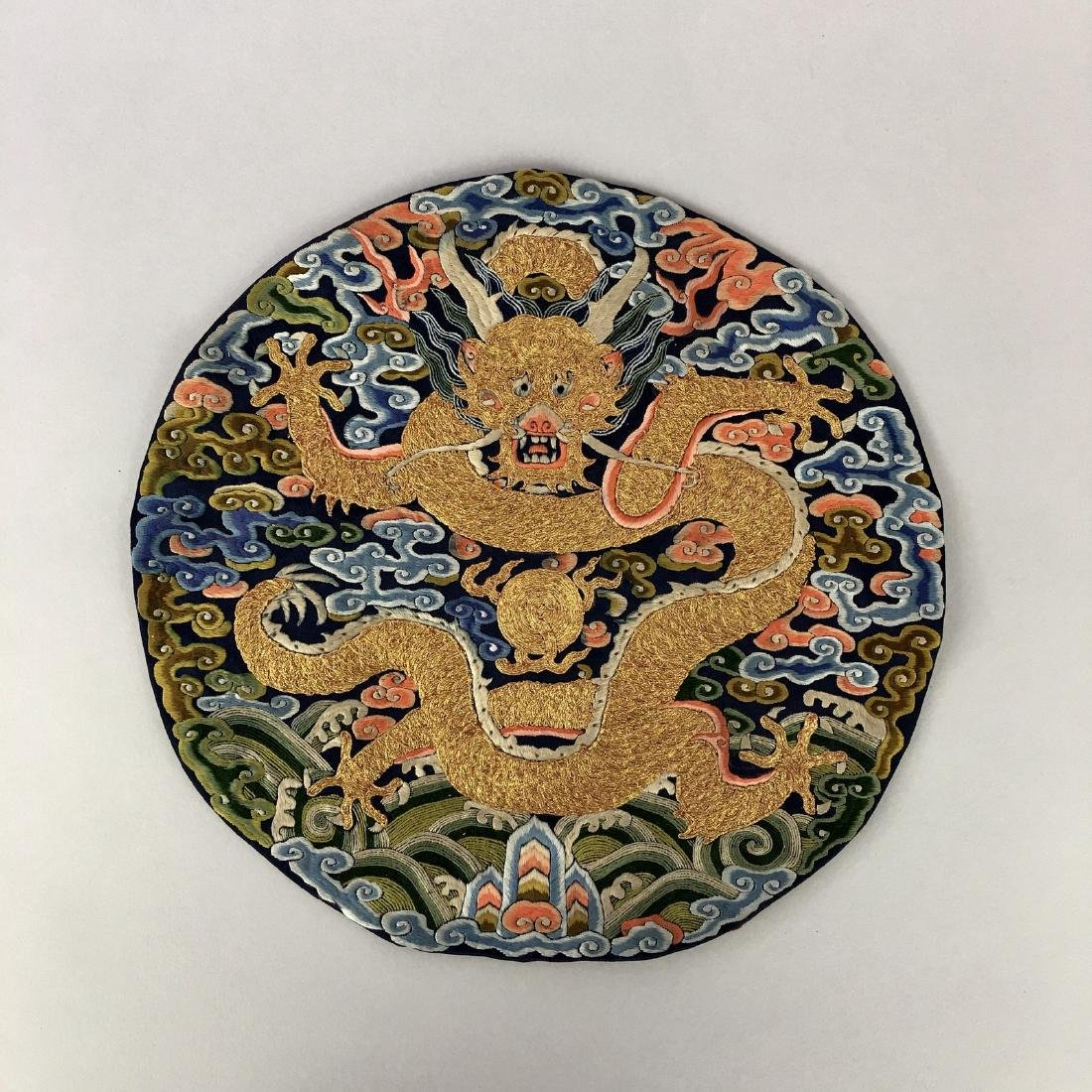 A CHINESE SILK EMBROIDERED DRAGON ROUNDEL