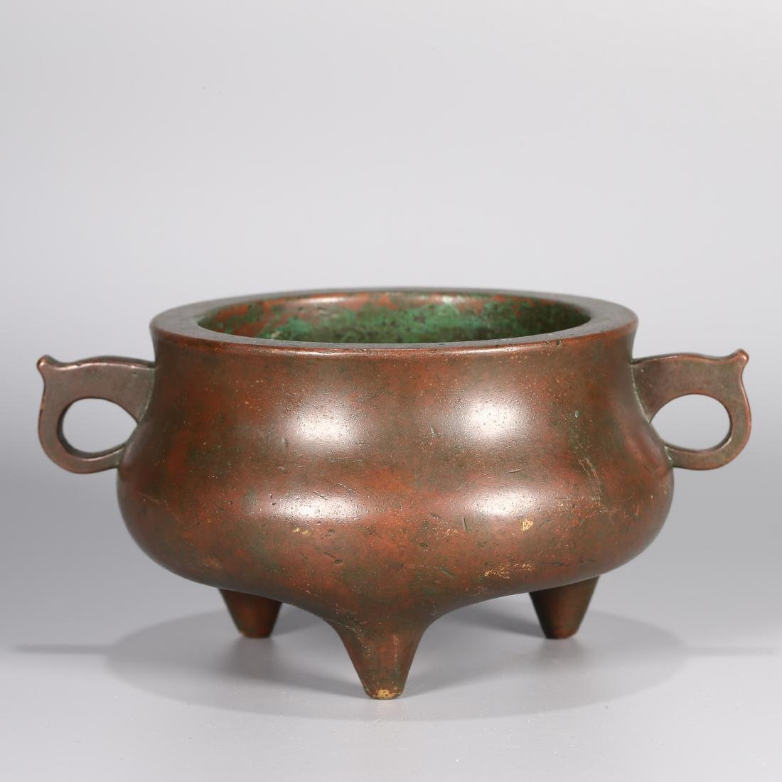 A CHINESE BRONZE TRIPOD DOUBLE HANDLED CENSER