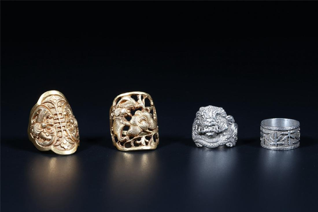 FOUR CHINESE SILVER ORNAMENTS