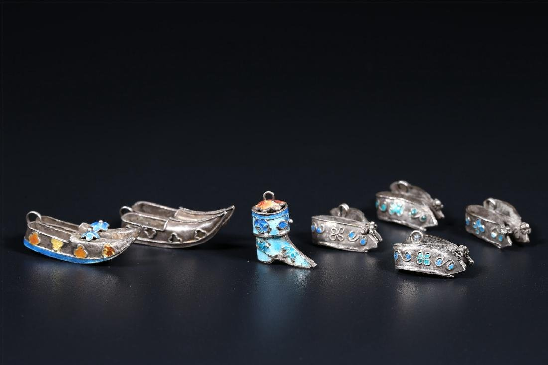 A GROUP OF CHINESE SILVER ORNAMENTS