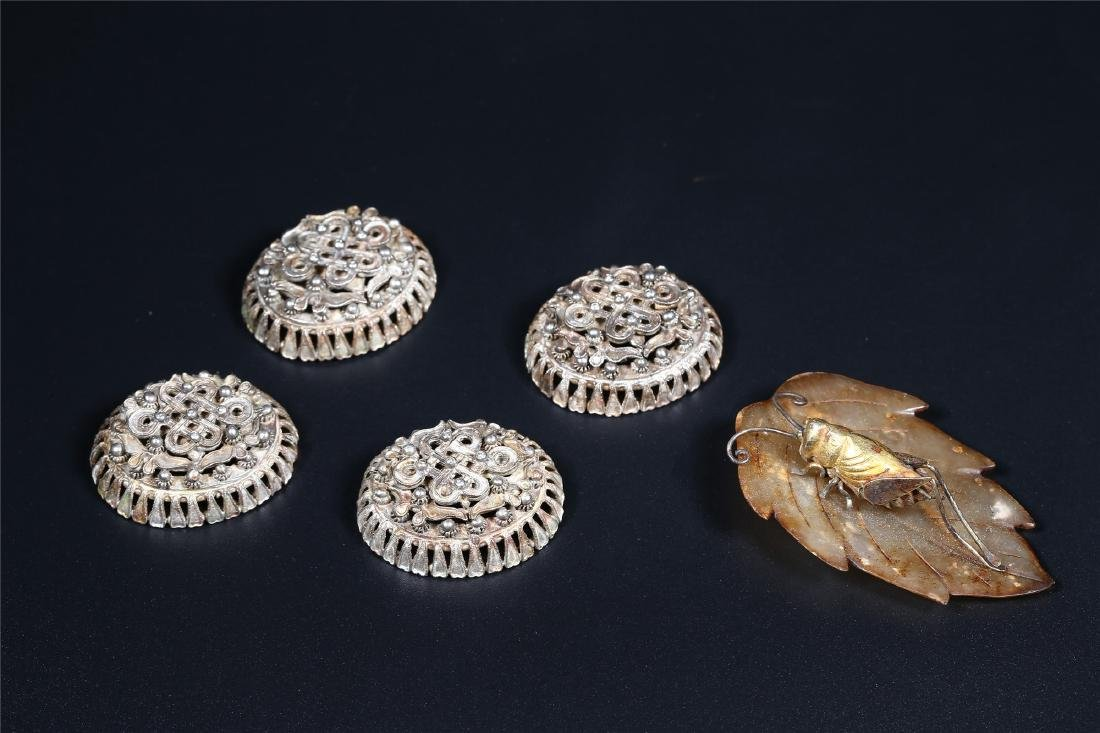 A GROUP OF SILVER ORNAMENTS