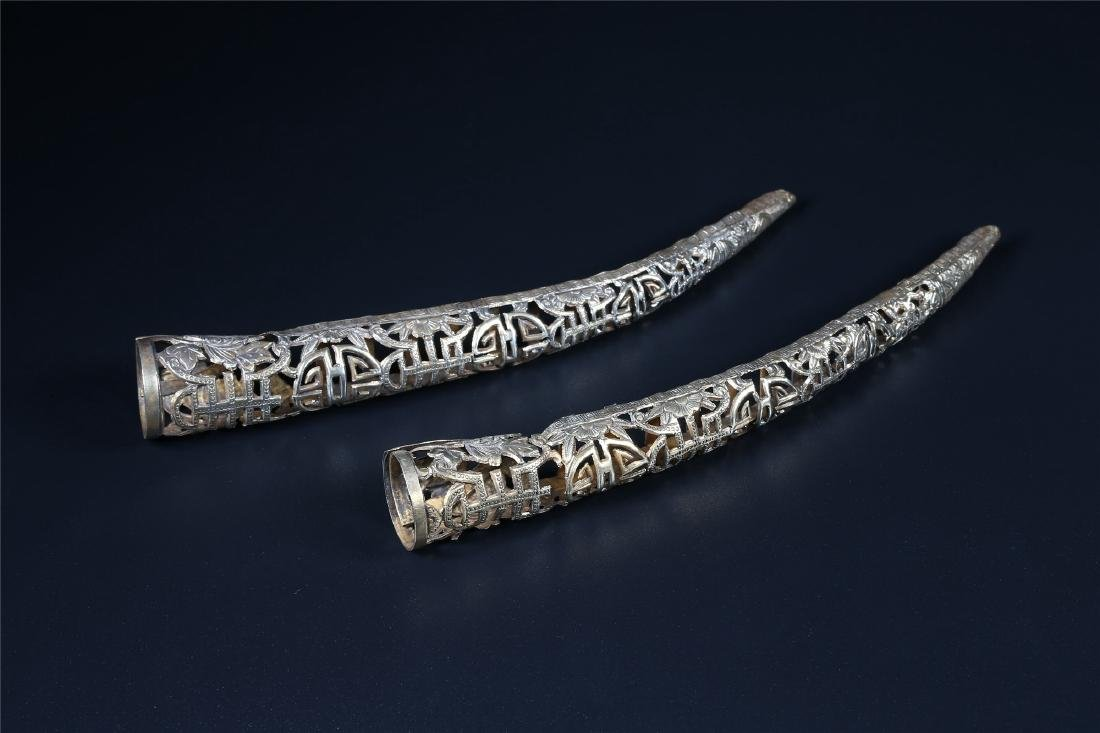 A PAIR OF CHINESE SILVER NAIL ORNAMENTS