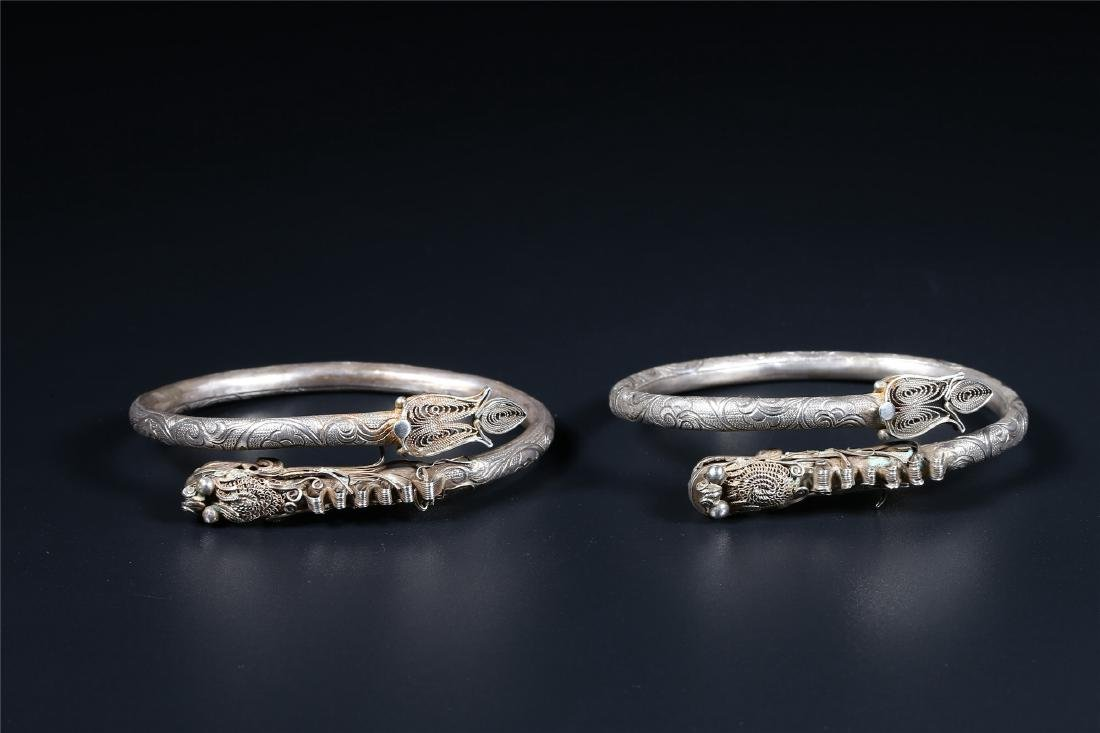 """A PAIR OF CHINESE SILVER """"DRAGON"""" BANGLES"""