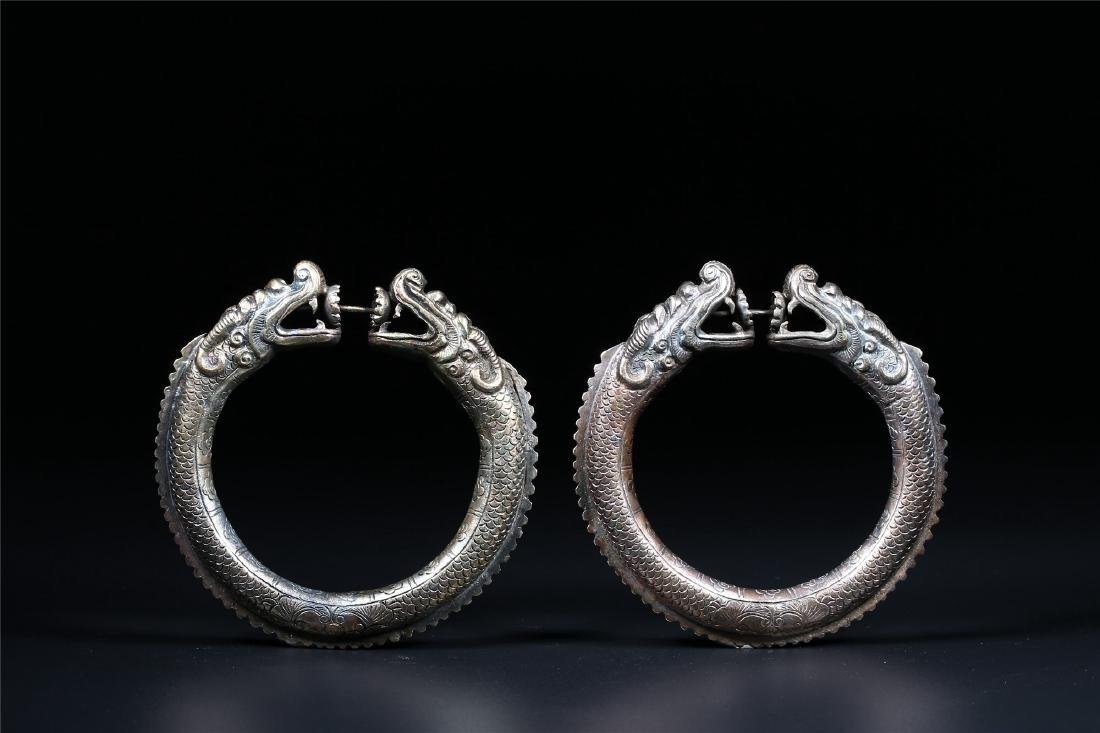 """A PAIR OF CHINESE SILVER """"DOUBLE DRAGONS"""" BANGLES"""