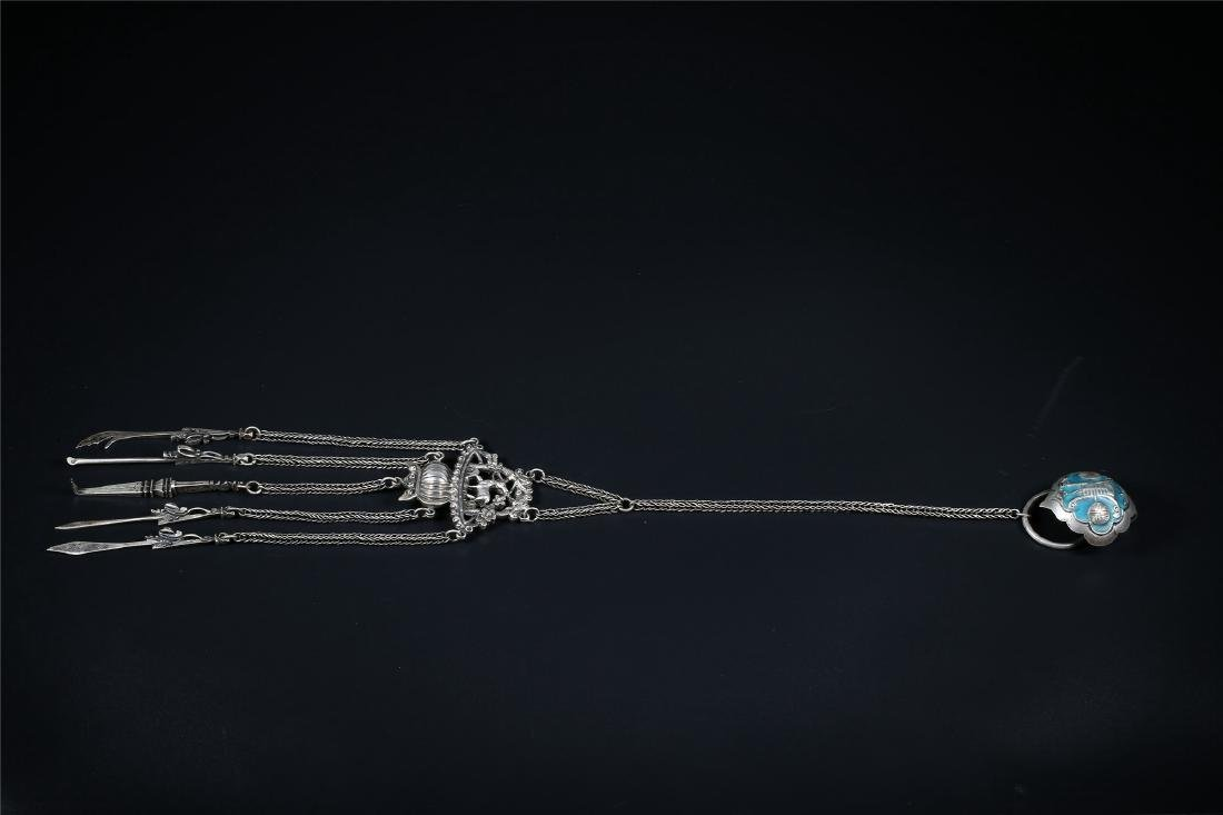 A CHINESE SILVER ORNAMENT