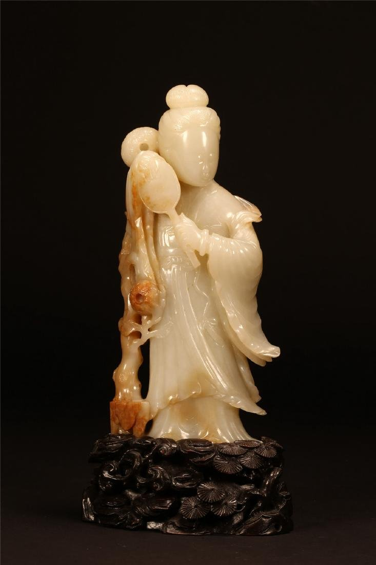 A CHINESE WHITE JADE FIGURE OF A LADY