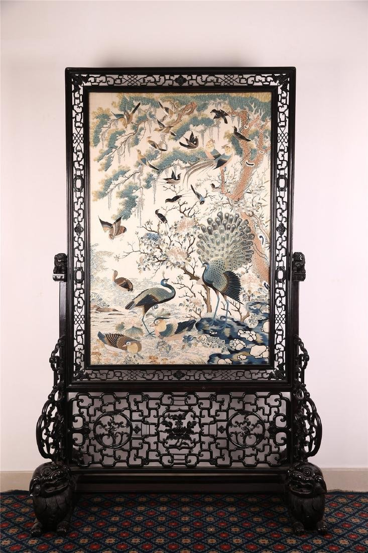A CHINESE FLOOR SCREEN WITH EMBROIDERED SILK PANEL