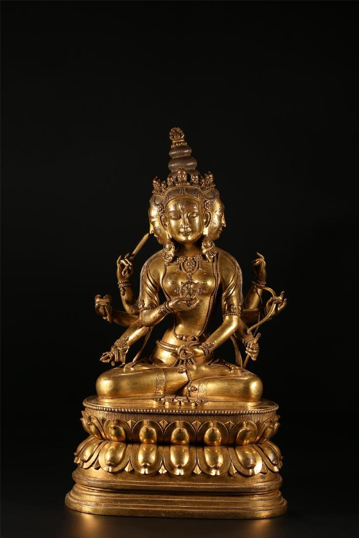 A CHINESE GILT BRONZE FIGURE OF EIGHT ARMED GUANYIN