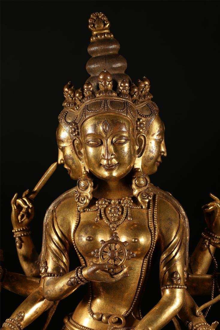 A CHINESE GILT BRONZE FIGURE OF EIGHT ARMED GUANYIN - 2