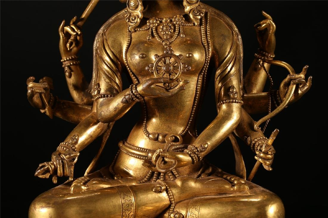 A CHINESE GILT BRONZE FIGURE OF EIGHT ARMED GUANYIN - 3