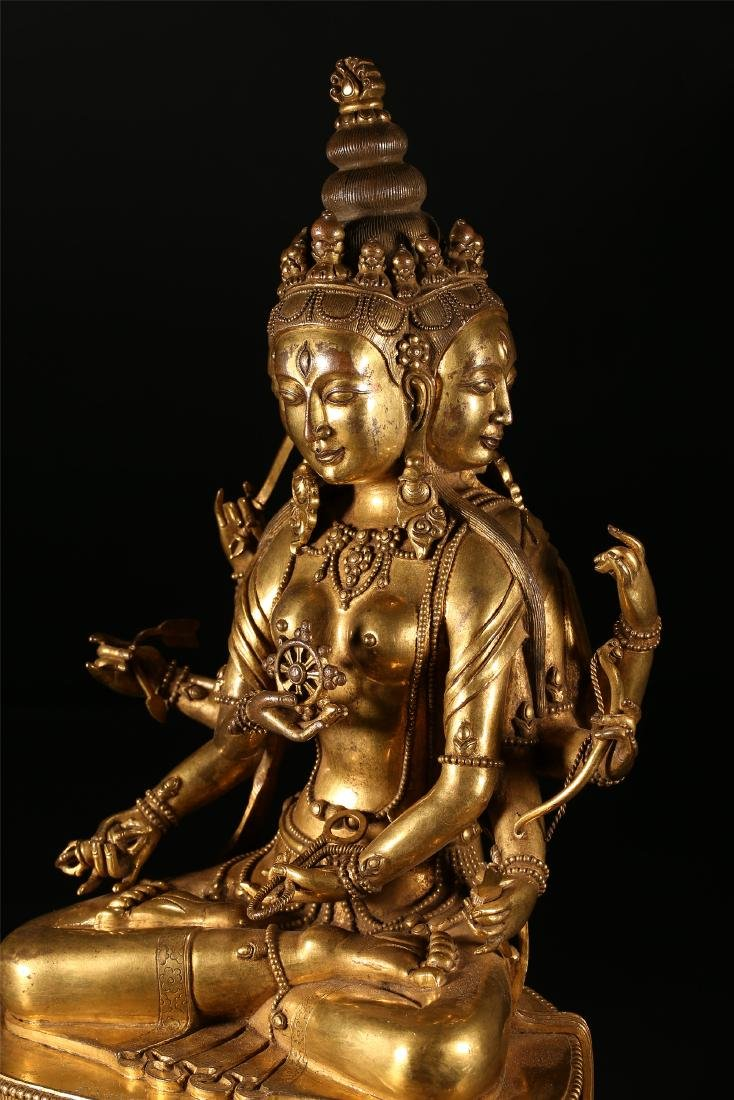 A CHINESE GILT BRONZE FIGURE OF EIGHT ARMED GUANYIN - 6