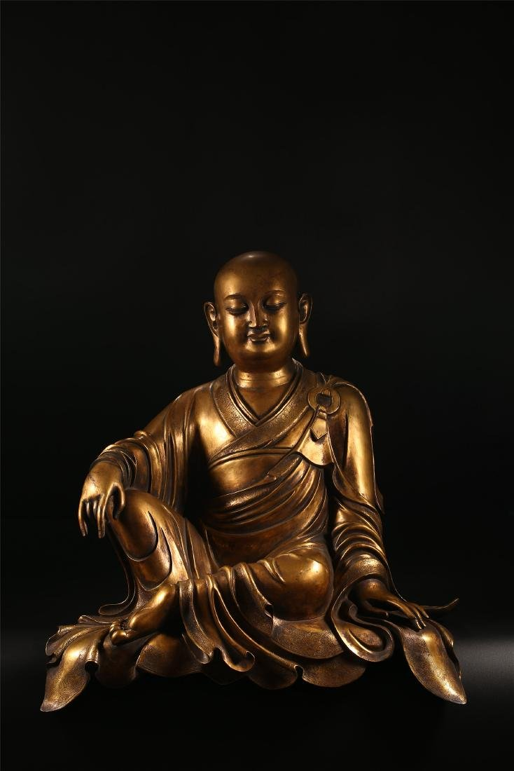 A CHINESE BRONZE FIGURE OF A LUOHAN